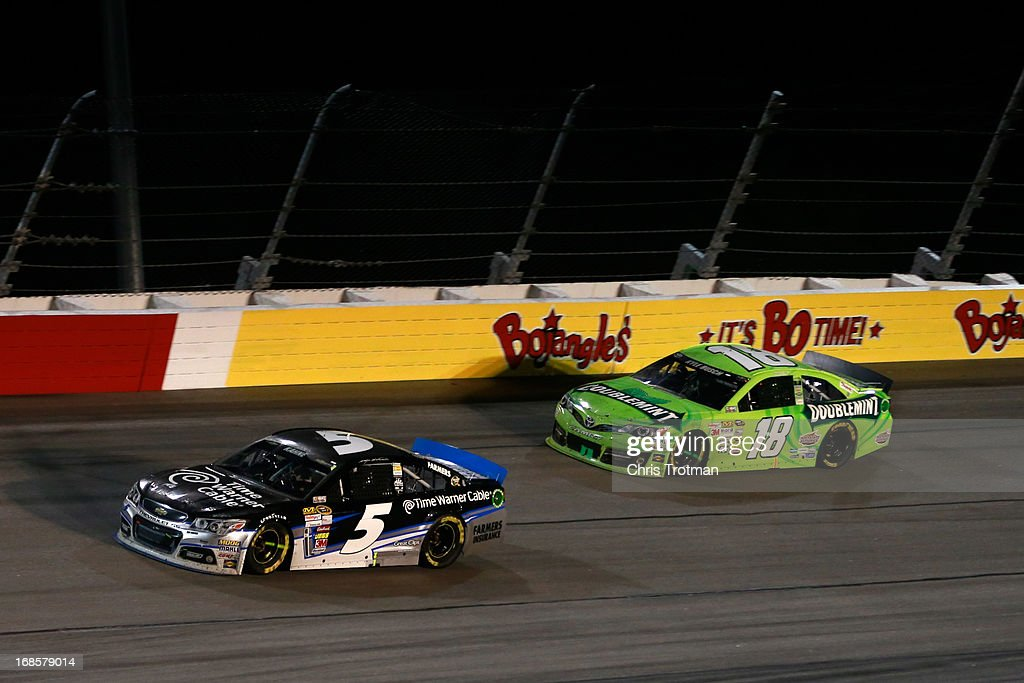 Kasey Kahne, driver of the #5 Time Warner Cable Chevrolet leads Kyle Busch, driver of the #18 Double Mint Gum Toyota during the NASCAR Sprint Cup Series Bojangles' Southern 500 at Darlington Raceway on May 11, 2013 in Darlington, South Carolina.