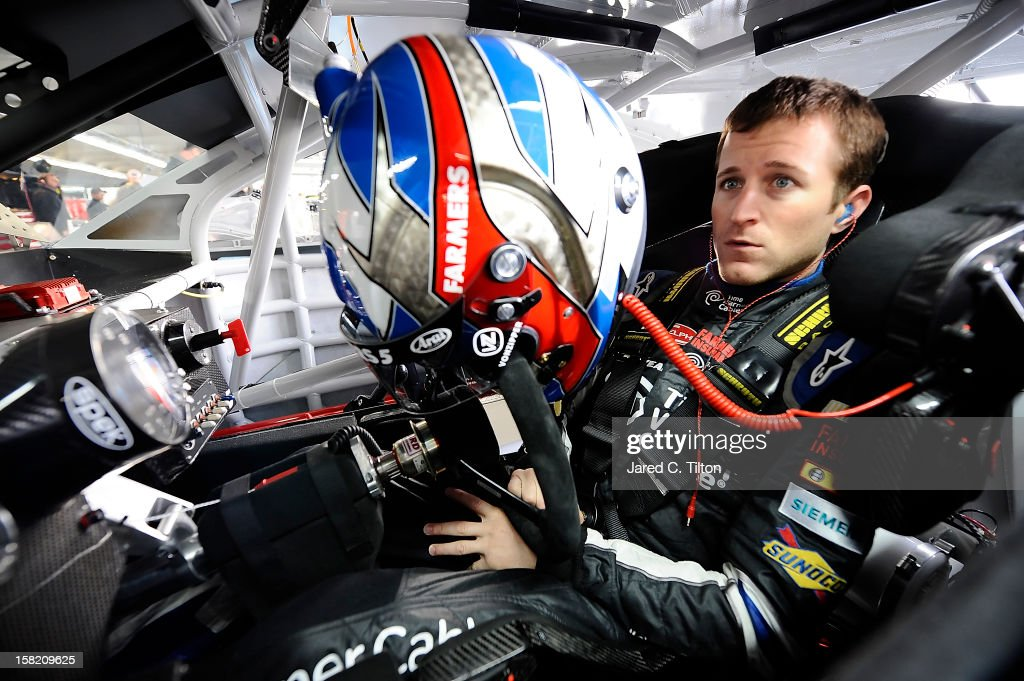 Kasey Kahne, driver of the #5 Time Warner Cable Chevrolet, looks on during testing at Charlotte Motor Speedway on December 11, 2012 in Concord, North Carolina.