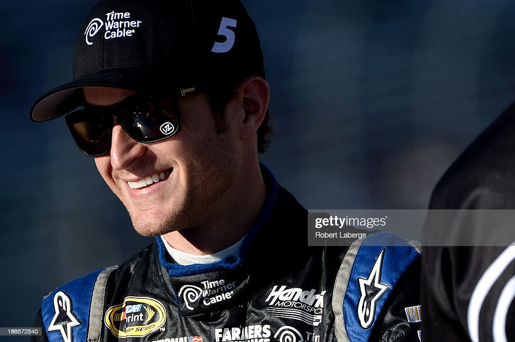 Kasey Kahne, driver of the #5 Time Warner Cable Chevrolet, looks on from the grid during qualifying for the NASCAR Sprint Cup Series AAA Texas 500 at Texas Motor Speedway on November 1, 2013 in Fort Worth, Texas.