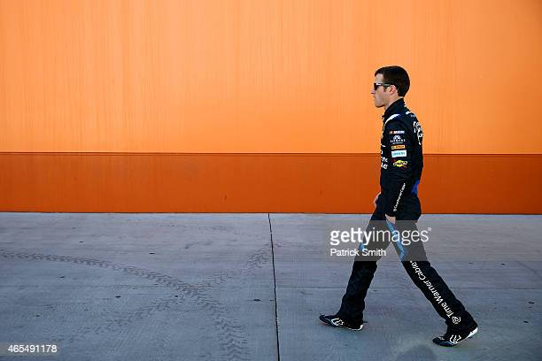 Kasey Kahne driver of the Time Warner Cable Chevrolet walks through the garage area during practice for the NASCAR Sprint Cup Series Kobalt 400 at...