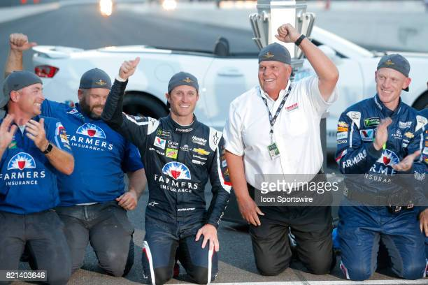 Kasey Kahne Hendrick Motorsports Chevrolet SS celebrates with team owner Rick Hendrick on the yard of bricks after winning the NASCAR Monster Energy...