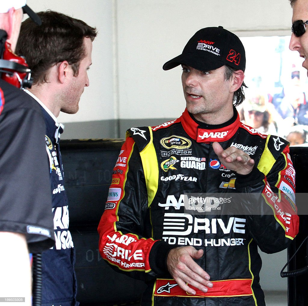 Kasey Kahne, left, talks to Jeff Gordon in the garage, after they both crashed in a 12-car pile-up during test trials at Daytona International Speedway in Daytona Beach, Florida, Friday, January 11, 2013.