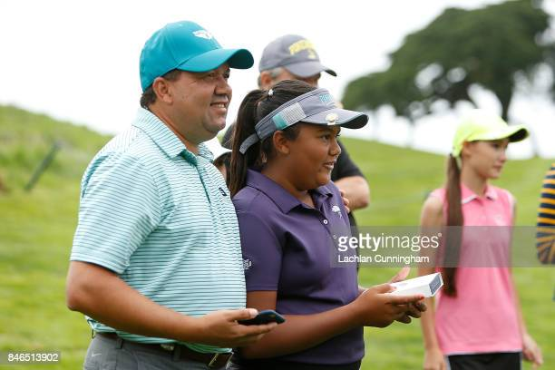Kasey Maralack celebrates after winning the Overall girls 1213 years division of the Drive Chip and Putt Western Region Qualifying tournament at The...