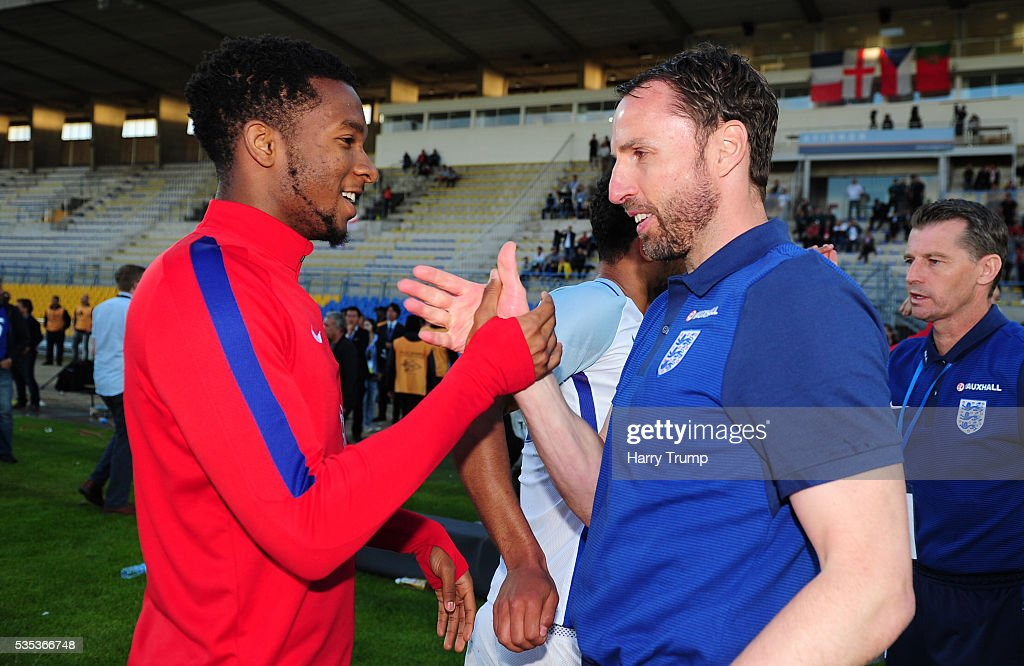 Kasey Palmer of England(L) celebrates with Gareth Southgate, Coach of England during the Final of the Toulon Tournament between England and France at Parc Des Sports on May 29, 2016 in Avignon, France.