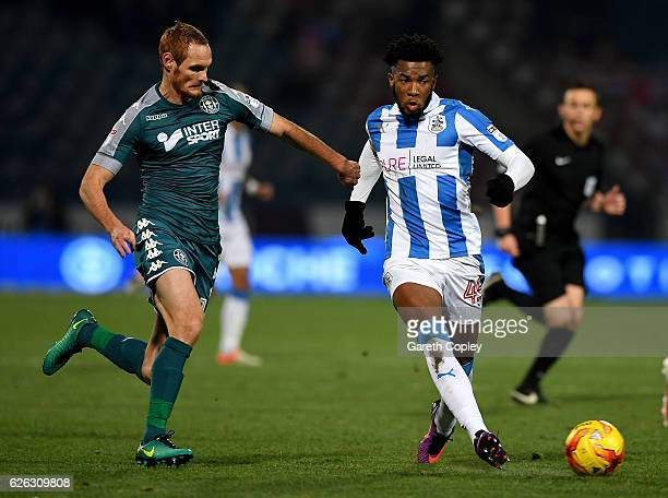 Kasey Palmer of Huddersfield gets past Shaun MacDonald of Wigan during the Sky Bet Championship match between Huddersfield Town and Wigan Athletic at...