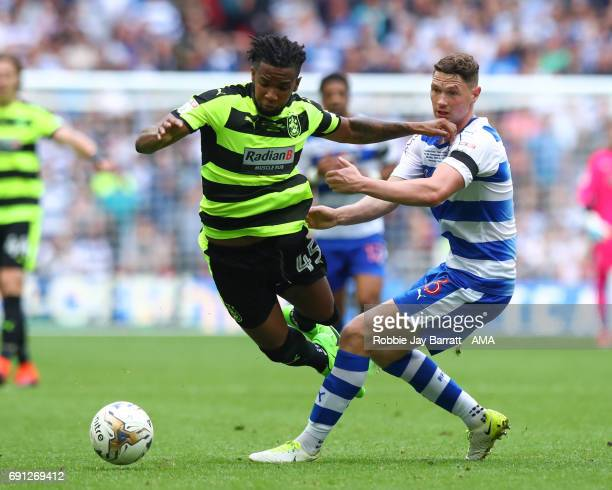 Kasey Palmer of Huddersfield Town and George Evans of Reading during the Sky Bet Championship Play Off Final match between Reading and Huddersfield...