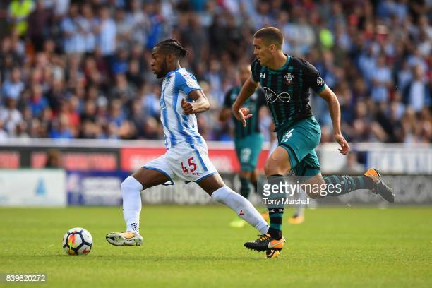 Kasey Palmer of Huddersfield Town is tackled by Oriol Romeu of Southampton during the Premier League match between Huddersfield Town and Southampton...