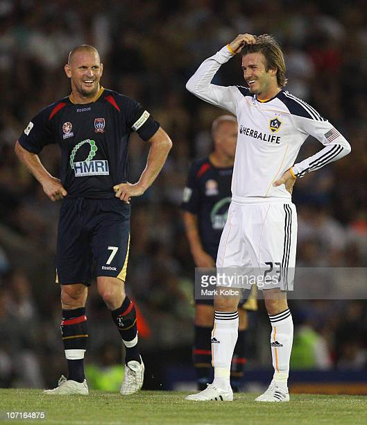 Kasey Wehrman of the Jets and David Beckham of the Galaxy share a laugh during the friendly match between the Newcastle Jets and the LA Galaxy at...