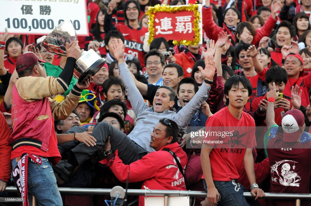 Kashima Antlers head coach Jorginho celebrates winning the J.League Yamazaki Nabisco Cup final between Shimizu S-Pulse and Kashima Antlers with supporters at the National Staidum on November 3, 2012 in Tokyo, Japan.