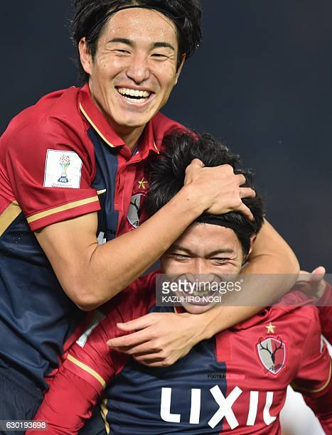 Kashima Antlers midfielder Gaku Shibasaki celebrates his goal with teammate Mu Kanazaki during the Club World Cup football final match between...