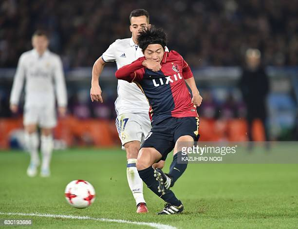 Kashima Antlers midfielder Gaku Shibasaki shoots to score his second goal as Real Madrid midfielder Lucas Vazquez looks on during the Club World Cup...