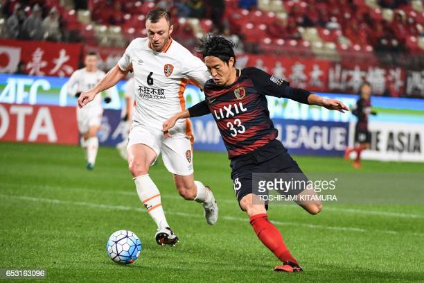 Kashima Antlers' midfielder Mu Kanazaki and Brisbane Roar's defender Avram Papadopoulos compete for the ball during the AFC Champions League football...