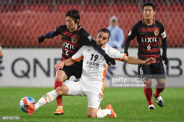 Kashima Antlers' midfielder Shoma Doi and Brisbane Roar's defender Jack Hingert compete for the ball during the AFC Champions League football match...