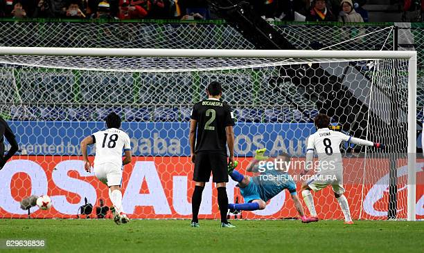 Kashima Antlers midfielder Shoma Doi scores a penalty goal during the Club World Cup football semifinal match between Colombia's Atletico Nacional...