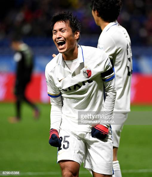 Kashima Antlers midfielder Yasushi Endo celebrates his goal during the Club World Cup football semifinal match between Colombia's Atletico Nacional...