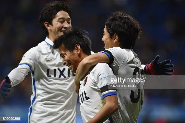 Kashima Antlers midfielder Yasushi Endo celebrates his goal with teammates during the Club World Cup football match between Kashima Antlers and...