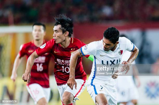 Kashima Forward Pedro Junior in action against Guangzhou Midfielder Zheng Zhi during the AFC Champions League 2017 Round of 16 match between...