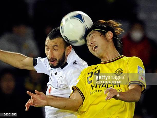 Kashiwa Reysol midfielder Koki Mizuno and AlSadd defender Nadir Belhadj vie for the ball during their third place playoff football match at the FIFA...