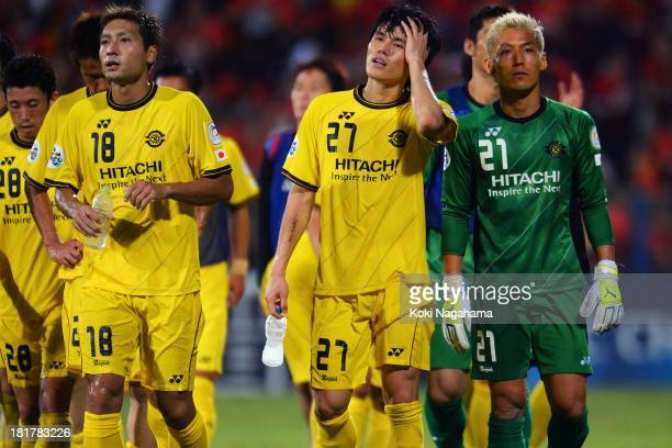 Kashiwa Reysol players look dejected after being defeated in the AFC Champions League Semi Final 1st Leg match between Kashiwa Reysol and Guangzhou...