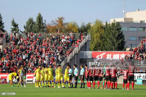 Kashiwa Reysol players shake hands with Consadole Sapporo players after their 03 lose in the JLeague J1 match between Consadole Sapporo and Kashiwa...