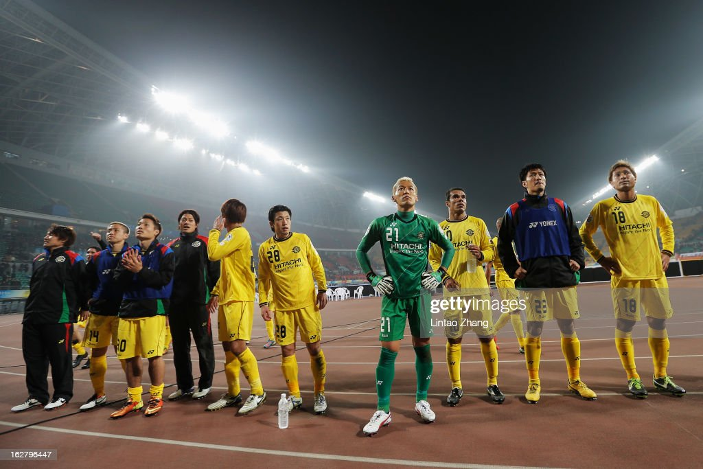 Kashiwa Reysol team line up to thank fans after win the match during the AFC Champions League match between Guizhou Renhe and Kashiwa Reysol on February 27, 2013 in Guiyang, China.