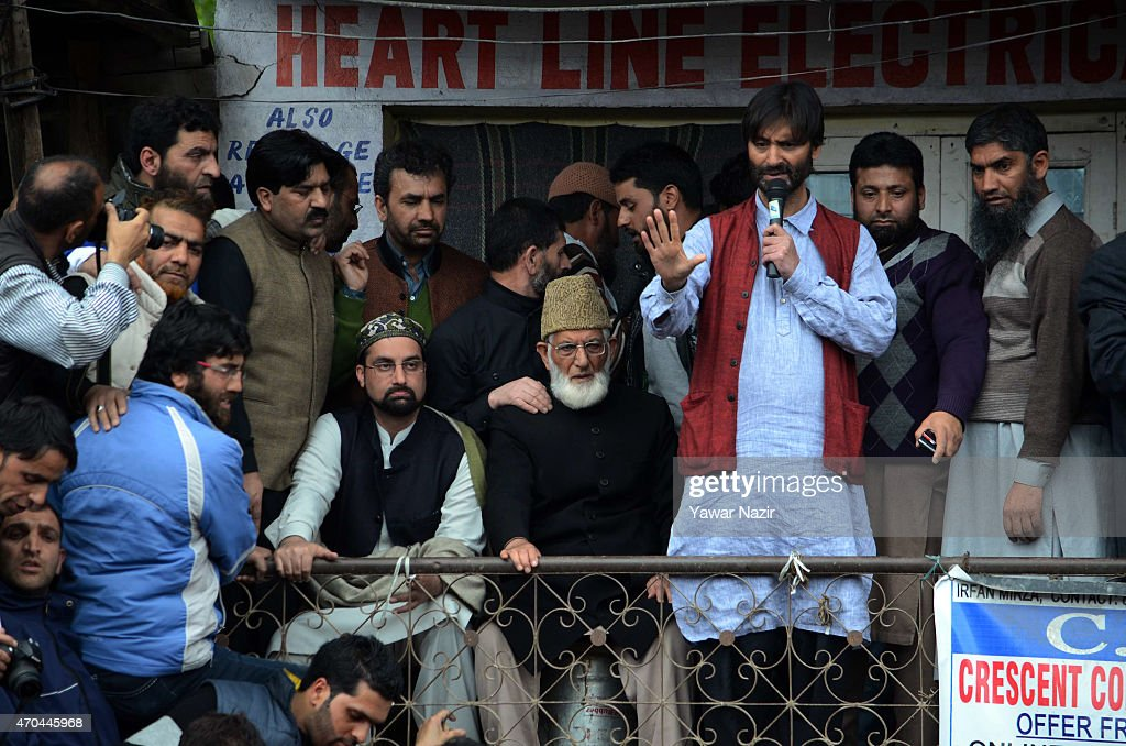 Kashmir chief priest and chairman of the All Parties Hurriyat Freedom Conference (APHC), Mirwaiz Umar Farooq (left) , Syed Ali Shah Geelani, a separatist leader and chairman of the hardliner faction of Kashmir's Hurriyat (Freedom) Conference and Kashmir Pro Independence leader and chief of Jammu and Kashmir Liberation Front Muhammad Yasin Malik address a gathering where a teenager was killed by Indian police last week, on April 20, 2015 in Narba 16 Km (9 miles) west of Srinagar, the summer capital of Indian administered Kashmir, India.In a rare show of expressing solidarity together, three top most anti-India leaders in Kashmir on Monday jointly addressed a condolence meeting held in the memory of a teenage boy who was killed in Police firing last week. The three leaders visited the bereaved family and condemned the killing of teenage Suhail Ahmad Sofi. Sofi was killed when Indian government forces fired on protesters in Narbal on Saturday, last week. This is for the first time that the divided resistance leadersÕ camp in Kashmir has shared a dais in past many years. Terming the continuous state terrorism and massacre of youth by the Indian government forces in Kashmir as highly condemnable.