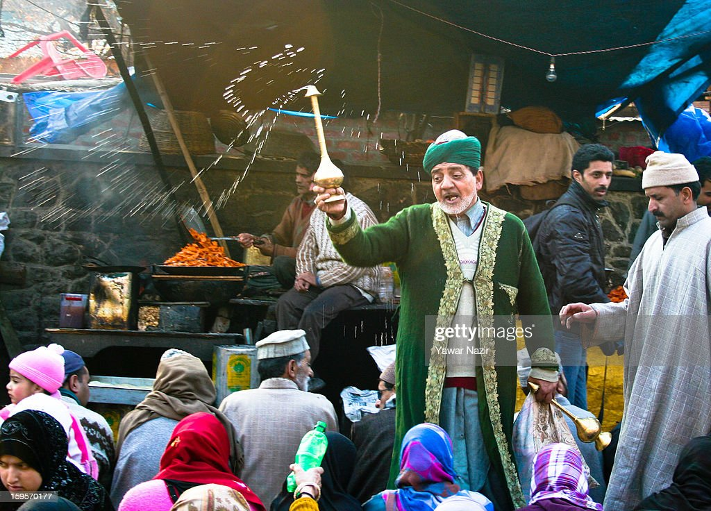 A Kashmir Muslim sprinkles rose water on the Muslim devotees outside the shrine of Khwaja Naqshband on January 16, 2013 in Srinagar, the summer capital of Indian-administered Kashmir, India. Thousands of devotees from across Kashmir converge at the shrine of Khwaja Naqshband Sahib in downtown Srinagar to participate in annual congregational prayers called 'Khoja Digar' on the 3rd of Rabi-ul-Awal, the third month of the Islamic calendar.