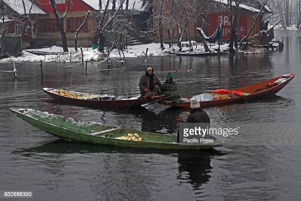 Kashmir Muslim vegetable seller in the floating market during amid snowfall The Valley continue to received snowfall from past couple of days while...