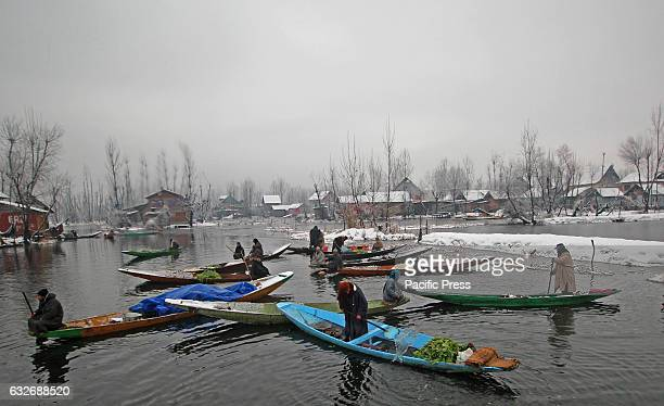 Kashmir Muslim vegetable sellers during amid snowfall near the floating market The Valley continue to received snowfall from past couple of days...
