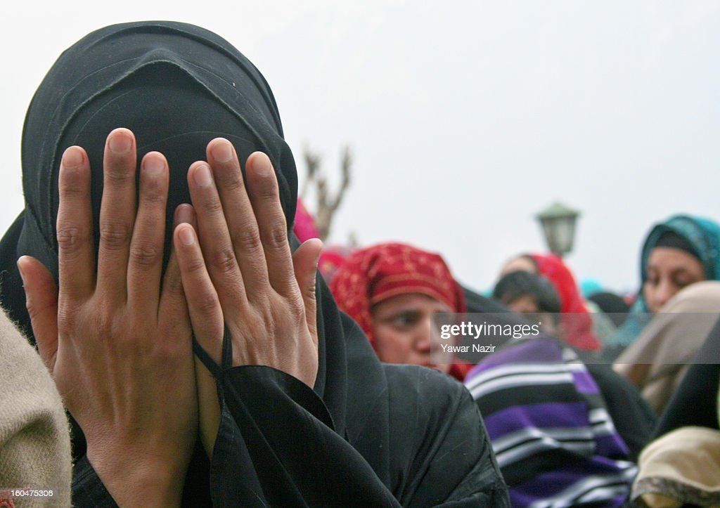 A Kashmir Muslim woman prays at Hazratbal shrine on the Friday following Eid-e-Milad , or the birth anniversary of Prophet Mohammad on February 01, 2013 in Srinagar, the summer capital of Indian administered Kashmir, India. Thousands of Muslims from all over Kashmir visit the Hazratbal shrine in Srinagar to pay obeisance on the Friday following Eid-e-Milad , or the birth anniversary of Prophet Mohammed. The shrine is highly revered by Kashmiri Muslims as it is believed to house a holy relic of the Prophet Mohammed. The relic is displayed to the devotees on important Islamic days such as the Eid- Milad when Muslims worldwide celebrate.