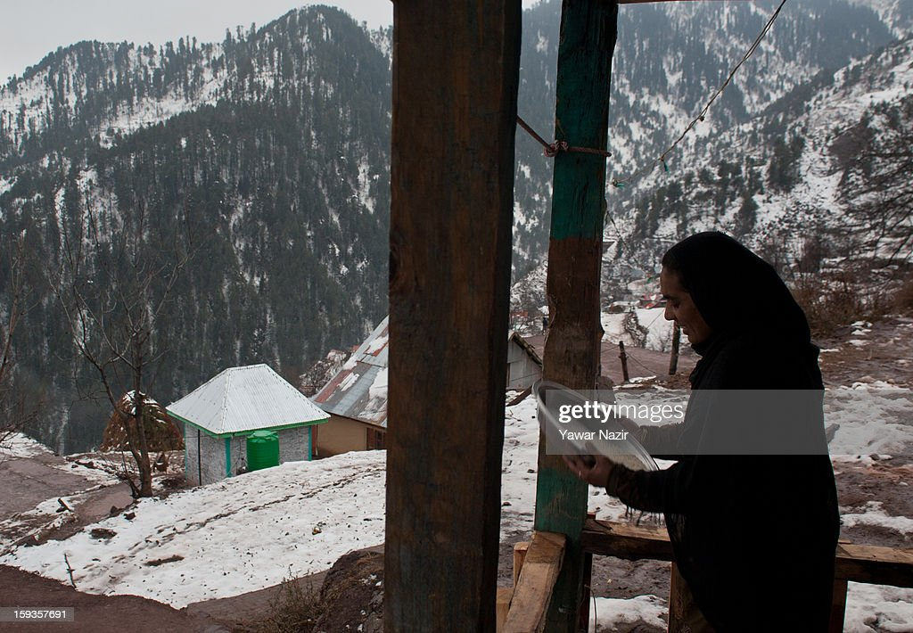 A Kashmir Muslim woman winnowing grains by her home in Churunda village on January 12, 2013, northwest of Srinagar, the summer capital of Indian Administered Kashshmir, India. The village with a population of a little over 12,000 people has been bearing the brunt of cross-fire between nuclear rivals India and Pakistan. Last week a Pakistan solider was killed across the Line of Control (LOC), a military line that divides Indian-administered Kashmir from the Pakistan-administered Kashmir at this village. People living along the LoC have continually been at risk due to hostility between the armies of the two rival nations. Last year, in November, three people, including a pregnant woman, had died after a shell fired from Pakistan landed on one of the houses in the village. Tension between Pakistan and India has escalated after a fresh skimirish along the border. Both countries have summoned each other's envoy to protest against unacceptable and unprovoked' attacks.