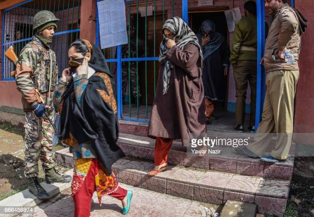 Kashmir Muslim women come out of the polling station after casting their votes during the elections of the lower house of Indian parliament on April...