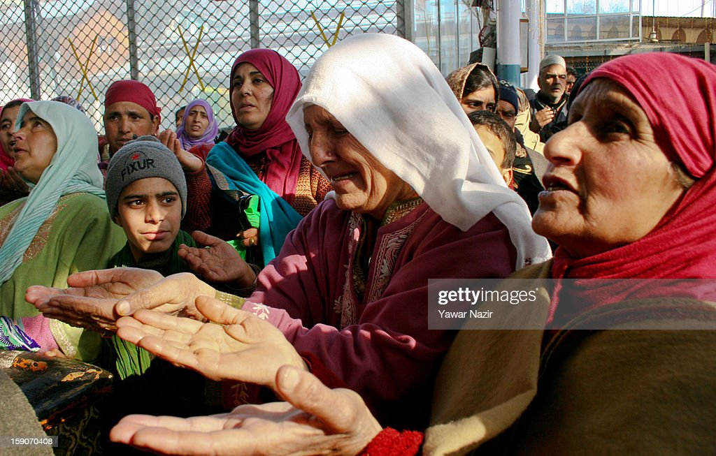 Kashmir Muslim women devotees pray at the shrine of the Sufi saint Sheikh Hamza Makhdoom during a festival on January 7, 2013 in Srinagar, the summer capital of Indian administered Kashmir, India. Thousands of Kashmiri Sufi Muslims make the pilgrimage to the shrine of Sufi Saint Sheikh Hamza Makhdoomi, also known as Makhdoom Sahib, to offer prayers on the anniversary of his birth.