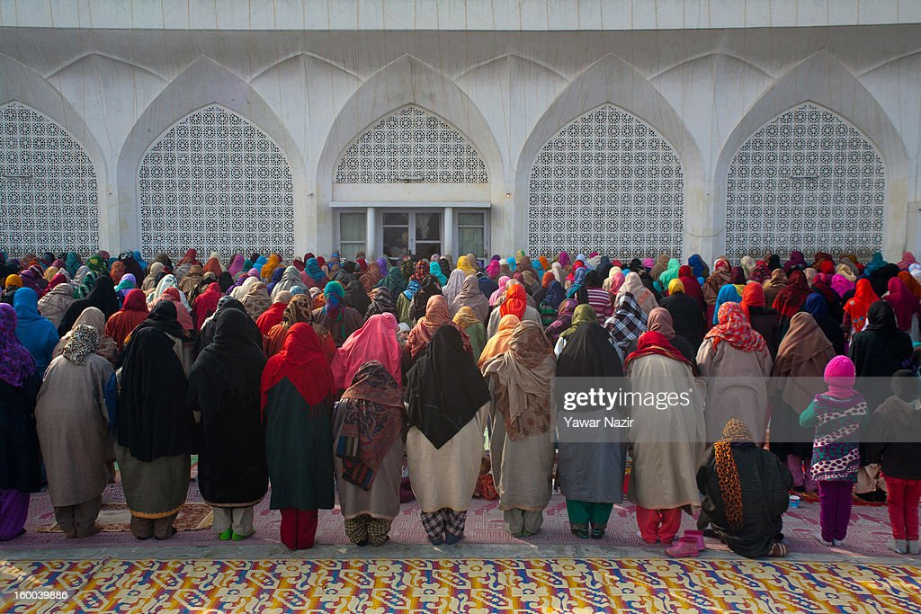 Kashmir Muslim women pray at Hazratbal shrine during Eid-e-Milad, the anniversary of the birth of the Prophet Mohammed January 25, 2013 in Srinagar, the summer capital of Indian administered Kashmir, India. Thousands of Muslims from different parts of Kashmir will visit the Hazratbal shrine in Srinagar to pay obeisance on the occasion of Eid-e-Milad. The shrine is highly revered by Kashmiri Muslims as it is believed to house a holy relic of the Prophet Mohammed. The relic is displayed to the devotees on important Islamic days such as the Eid- Milad when Muslims worldwide celebrate the Prophet Mohammed.