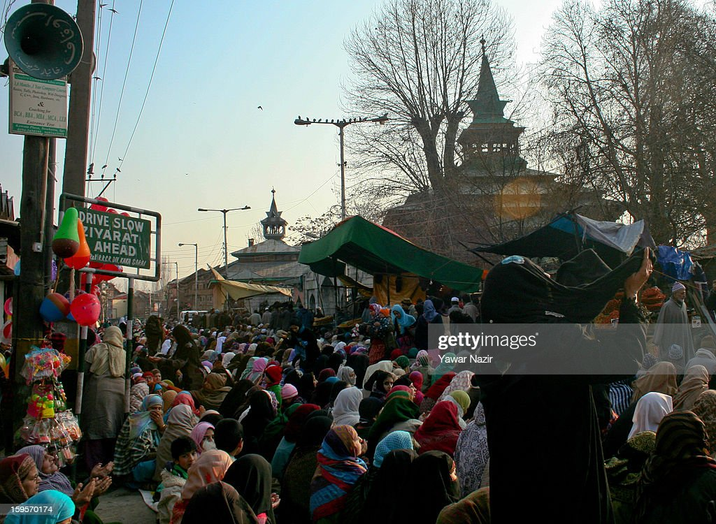 Kashmir Muslim women pray outside the shrine of Khwaja Naqshband on January 16, 2013 in Srinagar, the summer capital of Indian-administered Kashmir, India. Thousands of devotees from across Kashmir converge at the shrine of Khwaja Naqshband Sahib in downtown Srinagar to participate in annual congregational prayers called 'Khoja Digar' on the 3rd of Rabi-ul-Awal, the third month of the Islamic calendar.