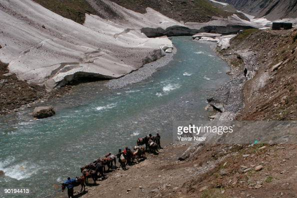Kashmir nomads quench their thirst of their ponies on a trekking route on August 31 2009 in Sonamarg about 96 Km northeast of Srinagar in Indian...