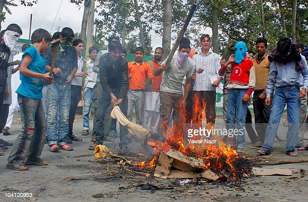 Kashmir protesters beat a burning effigy that symbolized the Indian government during a protest despite a strict curfew on September 15 2010 in...
