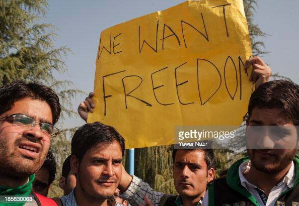Kashmir Students hold placards and banners during a protest against India on October 25 2013 in Srinagar the summer capital of Indian administered...