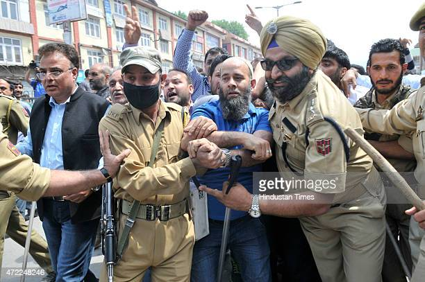 Kashmir Traders and Manufacturers Federation and other trade bodies scuffle with police persons as they try to march towards the office of the Jammu...