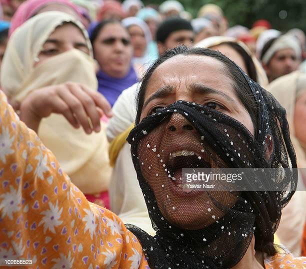 Kashmir woman shouts anti Indian slogans as she attends the funeral of Fayaz Ahmad and Muzzaffar Ahmad on July 6 2010 in Srinagar the summer capital...