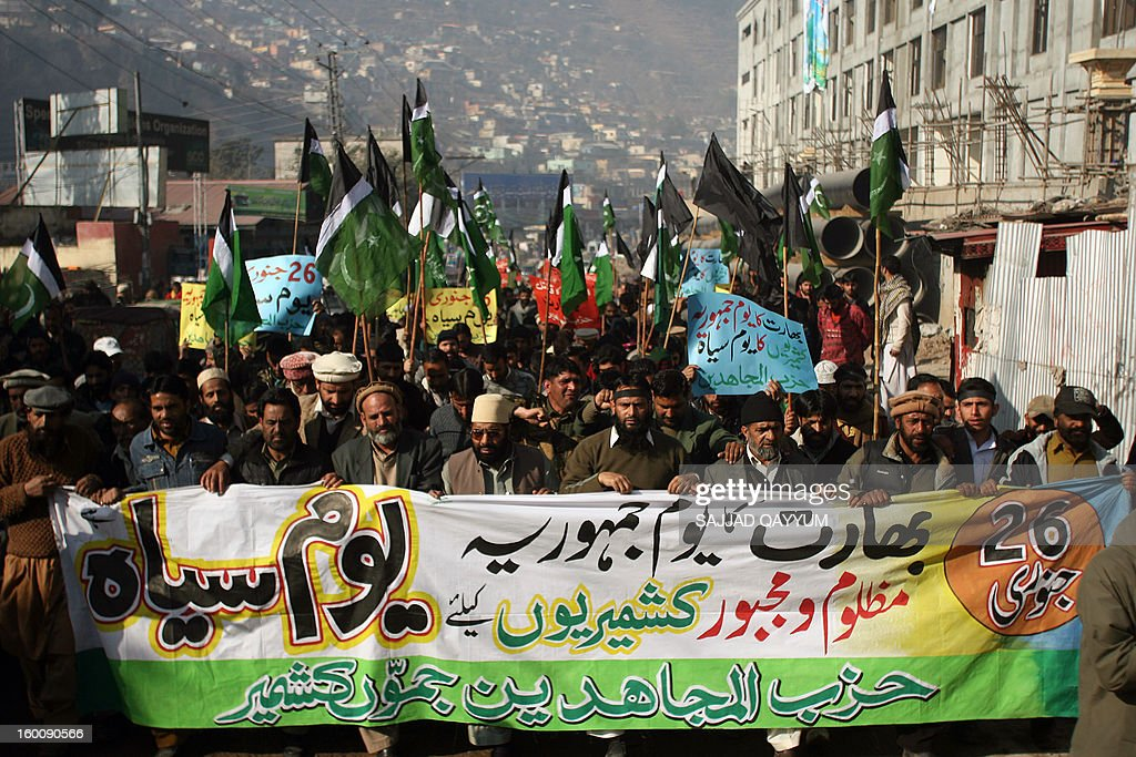 Kashmiri activists of Hizb-ul-Mujadedin, march at a rally in Muzaffarabad on January 26, 2013, to protest against the recent violation of the Line of Control by Indian troops and on the occasion of Indian Republic Day. India and Pakistan have fought three wars since partition in 1947, two of them over Kashmir, a territory which both claim. AFP PHOTO/Sajjad QAYYUM