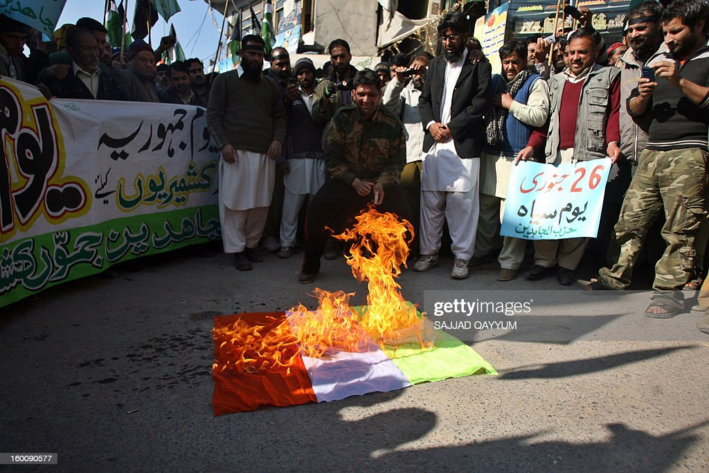 Kashmiri activists of Hizb-ul-Mujadedin set fire to the Indian flag at a rally in Muzaffarabad on January 26, 2013, to protest against the recent violation of the Line of Control by Indian troops and on the occasion of Indian Republic Day. ndia and Pakistan have fought three wars since partition in 1947, two of them over Kashmir, a territory which both claim. AFP PHOTO/Sajjad QAYYUM