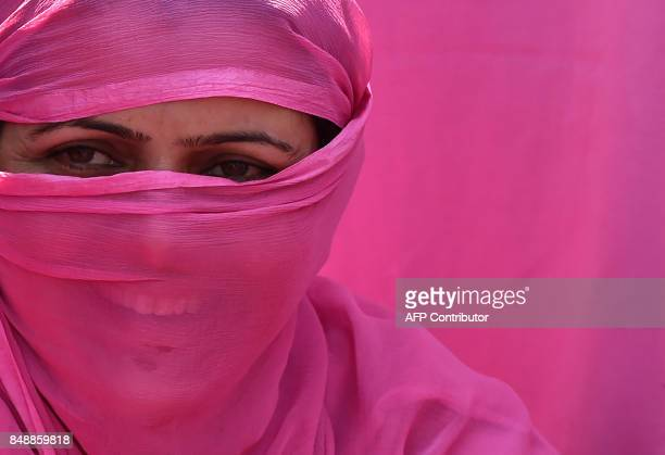 Kashmiri 'Anganwadi' a government sponsored child and mother care worker looks on during an anti government protest in Srinagar on September 18 2017...
