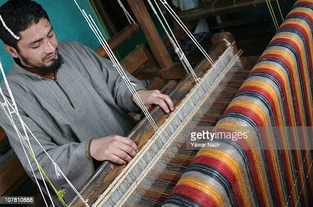 Kashmiri artisan works on a pashmina shawl at his workshop on December 29 2010 on the outskirts of Srinagar the summer capital of Indian administered...