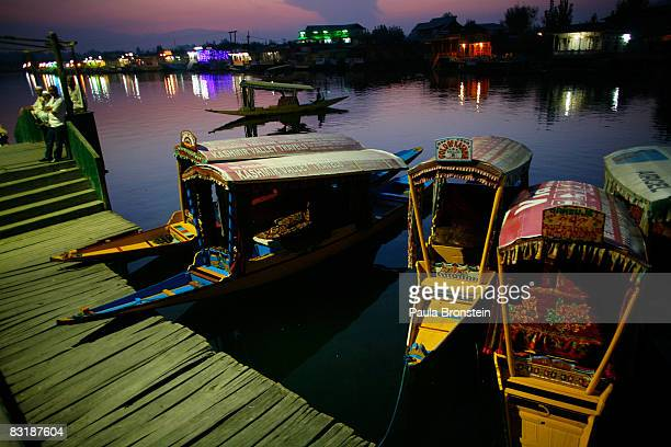 Kashmiri boatmen hangout by the dock after sunset on Dal Lake October 7 2008 in Srinagar Kashmir In the past few months the region's summer captiol...
