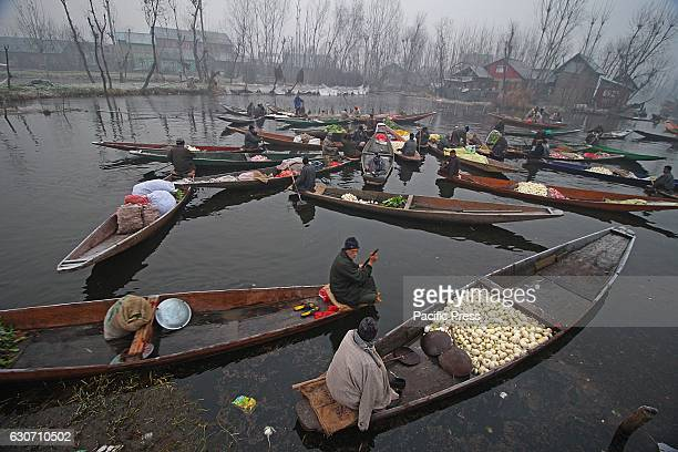 Kashmiri Boatmen wait for customers as they sell vegetables at the floating vegetable market in the interiors of famed Dal Lake in Srinagar the...