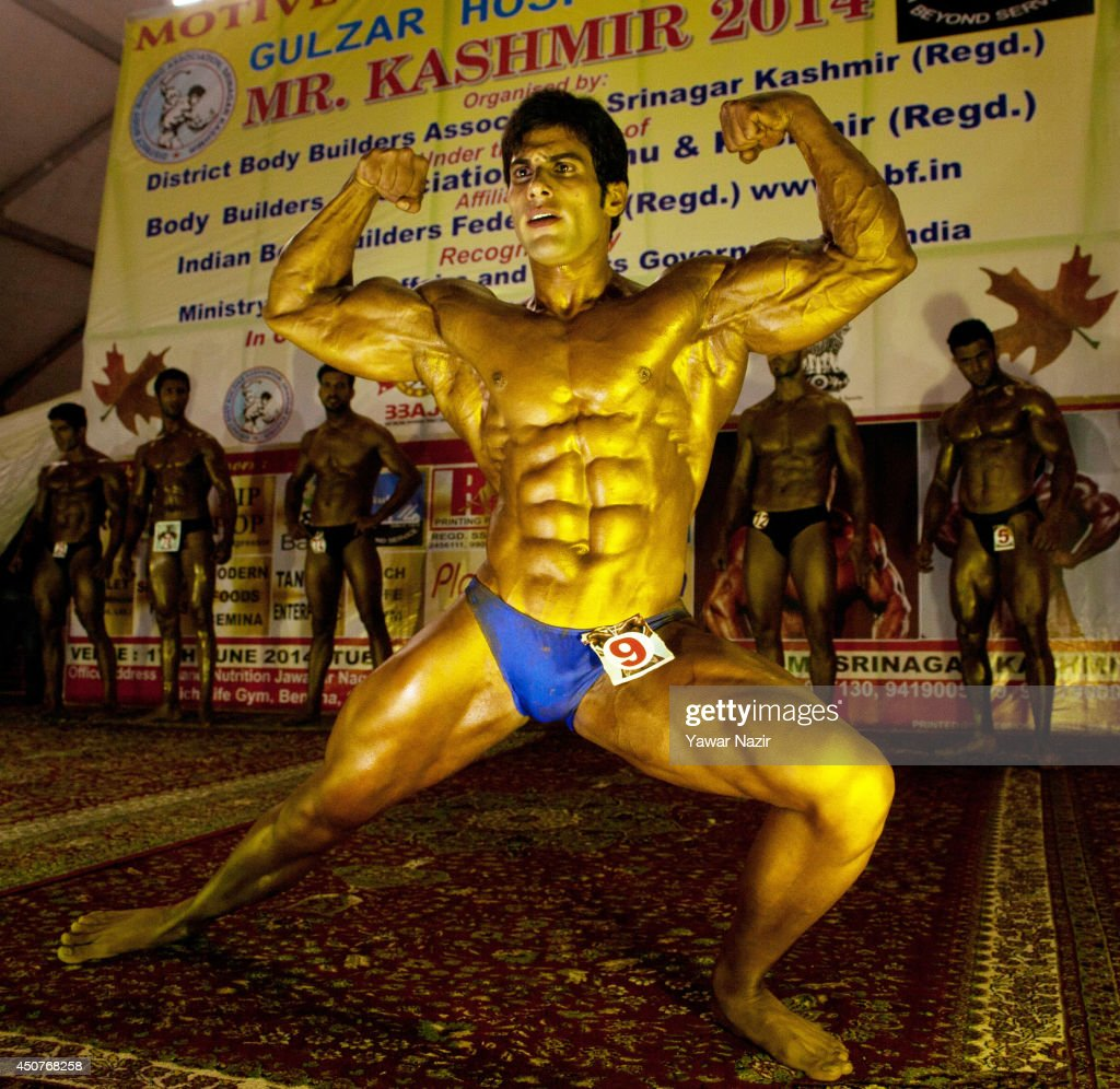 Kashmiri Body builder strikes a pose during the 'Mr. Kashmir Body Building Competition' organized by Jammu and Kashmir Bodybuilding Association on June 17, 2014 in Srinagar, the summer capital of Indian administered Kashmir, India. Kashmirs top bodybuilders competed in the championship in the strife torn valley where indoor sports have received a boost in the recent years. Bodybuilding has evolved as a popular sport in Kashmir with hundreds of gyms flourishing in the region.