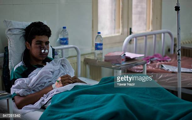 Kashmiri boy lies wounded after teargas shell of Indian government forces hit him during curfew after the killings of 39 Kashmir by government forces...