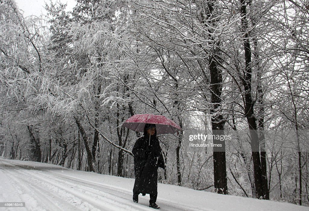 A Kashmiri boy walks on the road during a heavy snowfall on December 31, 2013 in Srinagar, India. Kashmir today received heavy snowfall in the beginning of its 40-day period of harsh winter. The strategic Srinagar-Jammu National Highway was closed in the morning due to heavy snowfall in Banihal and Patnitop sectors.