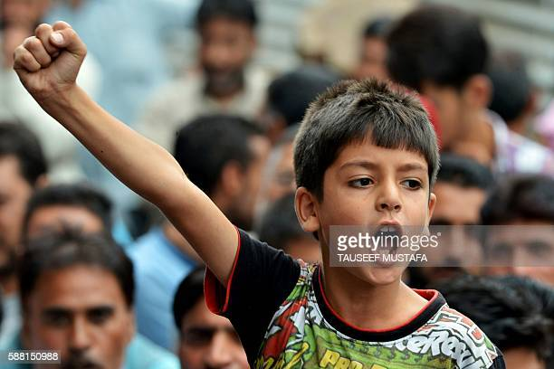 A Kashmiri child shouts antiIndian and profreedom slogans during a protest against a police officer who shot dead a local teenager allegedly inside...